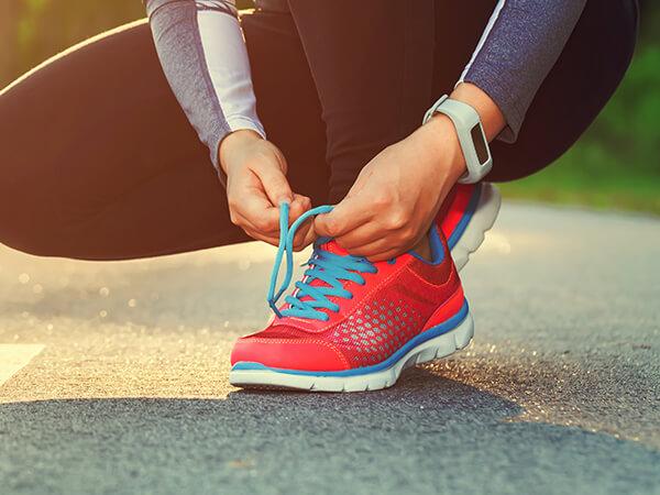 Woman Lacing Running Shoe