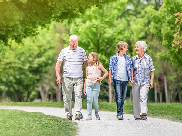 Family walking down park path